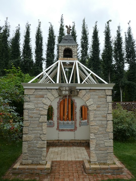 A small church/chapel with a squirrel statue on top